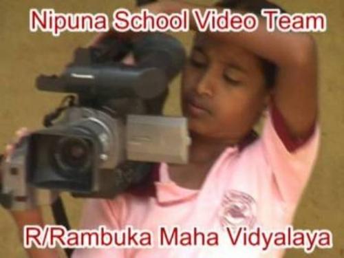 A member of school media unit in Rambuka eVillage
