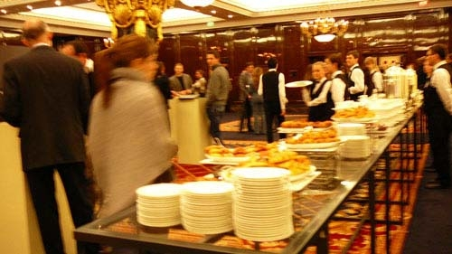 Press along with the guests enjoyed Russian-style banquet with some  black caviar on the table .