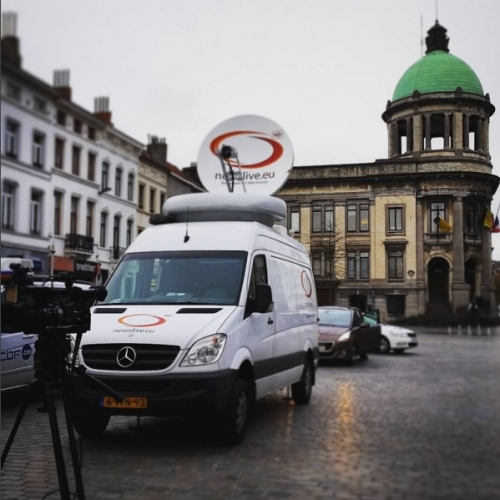 Satellite truck in Molenbeek Main Square doing uplinks for American TV.