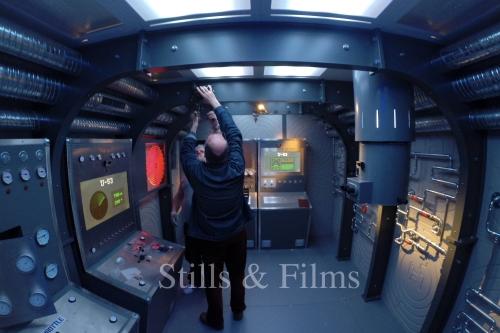 Stills & Films' Budapest camera crew setting up lights inside a game set