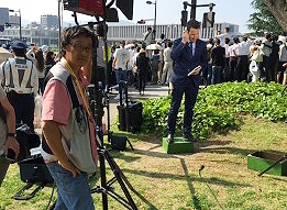 Tomoo ITOH of ITM filming a live transmission for a correspondent in Hiroshima.